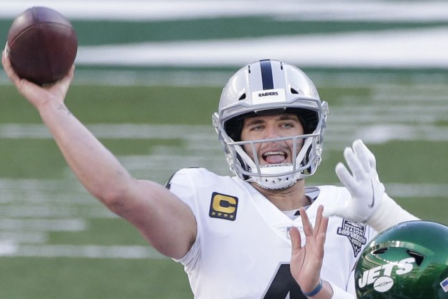 Las Vegas Raiders quarterback Derek Carr (pictured) said he hopes to reunite with wide receiver Davante Adams, his college teammate, after the 2021 season. File Photo by John Angelillo/UPI