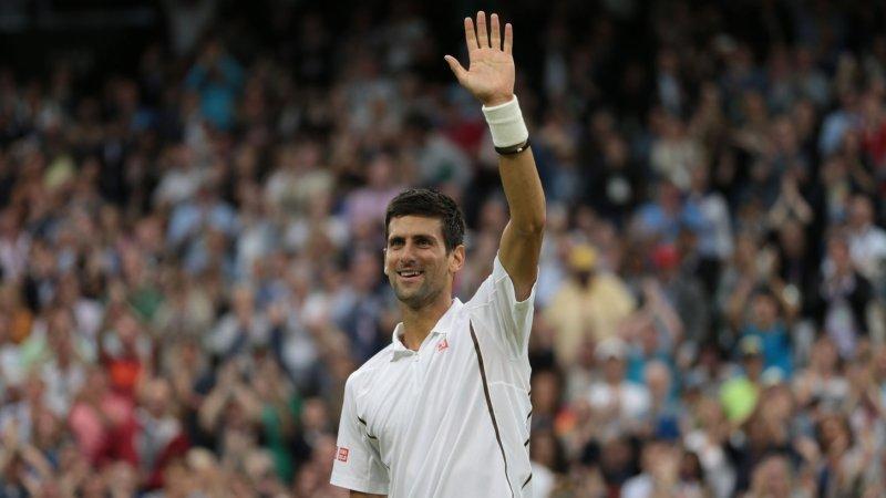 Serbian Novak Djokovic waves to the crowd on day four of the 2013 Wimbledon Championships in London on June 27, 2013. UPI/Hugo Philpott