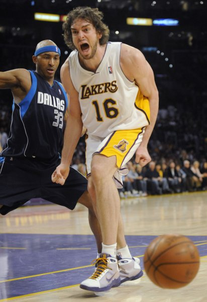 Angeles Lakers' Pau Gasol (16) reacts as the ball goes out as the Dallas Mavericks' James Singleton (33) looks on during the second half of an NBA basketball game in Los Angeles on March 15, 2009. Lakers won 107-100. (UPI Photo/ Phil McCarten)