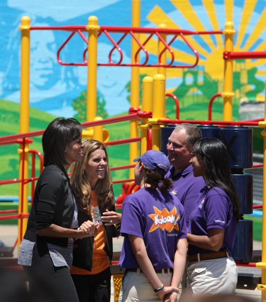 First Lady Michelle Obama (L) and California First Lady Maria Shriver talk to volunteers at Bret Harte Elementary School in San Francisco on June 22, 2009. The two paid a visit to a playground being built by volunteers. (UPI Photo/Terry Schmitt)