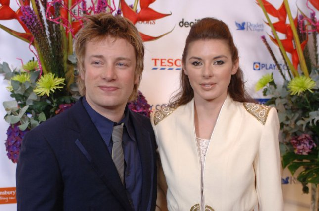 Jamie Oliver (L) and wife Jools at the British Book Awards on March 29, 2006. The couple recently welcomed their fifth child. File Photo by Rune Hellestad/UPI