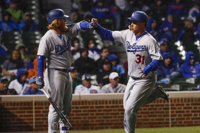Los Angeles Dodgers center fielder Joc Pederson (31) celebrates with third  baseman Justin Turner (10) after scoring. File photo by Kamil  Krzaczynski UPI ... fe2fbf073