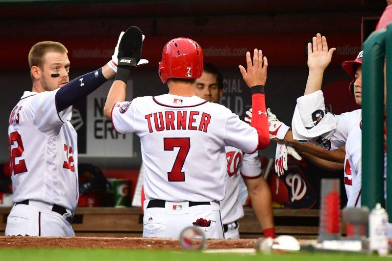 Washington Nationals shortstop Trea Turner (7) celebrates after scoring. File photo by Kevin Dietsch/UPI