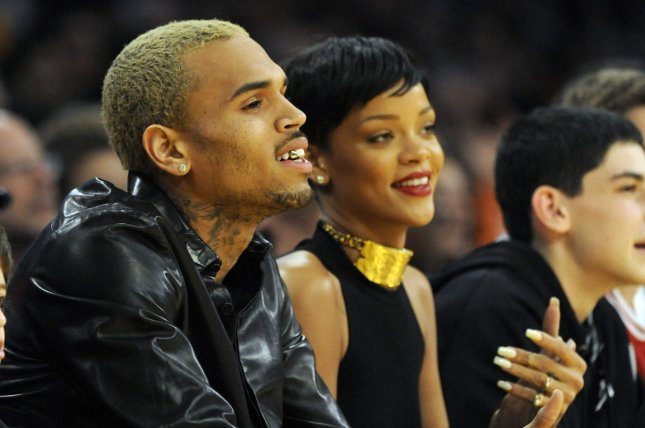 Rihanna fans furious as Chris Brown comments on festival photograph
