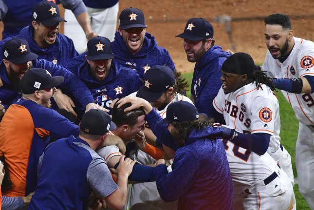 Players swarm Alex Bregman after his game-winning hit against the Los Angeles Dodgers in Game 5 of the 2017 World Series at Minute Maid Park in Houston, Texas, on October 29, 2017. File Photo by David Tulis/UPI