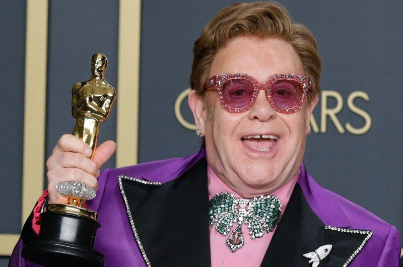 Elton John on Monday postponed a number of U.S. tour dates amid COVID-19. File Photo by John Angelillo/UPI