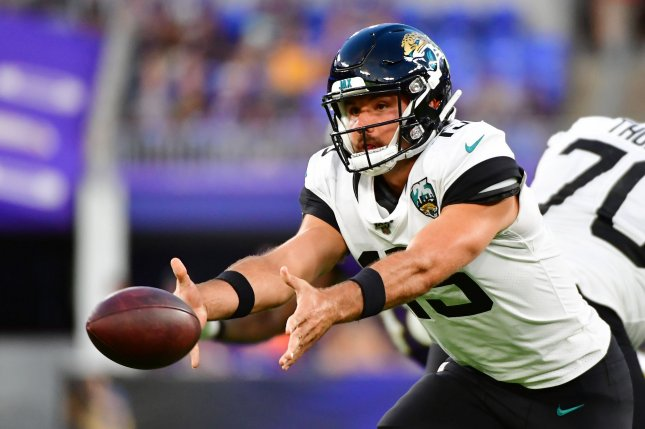Jacksonville Jaguars offensive coordinator Jay Gruden said he needs to find a way to mesh with second-year quarterback Gardner Minshew (15) and the rest of the team's quarterbacks before the 2020 season. File Photo by David Tulis/UPI