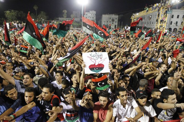 Libyans celebrate the overthrow of the Muammar Gaddafi regime at Martyrs' Square in Tripoli on the night of August 30, 2011 at the end of Ramadan.. UPI/Tarek Elframawy