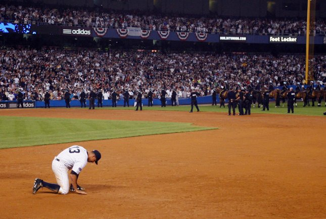 New York Yankees Alex Rodriguez plays with the dirt in the infield after the game against the Baltimore Orioles in the final game ever at Yankee Stadium in New York City on September 21, 2008. The Yankees defeated the Orioles 7-3. (UPI Photo/John Angelillo)