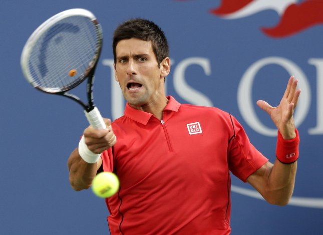 Novak Djokovic, shown during last year's U.S. Open, won in straight sets Monday as he opened his Australian Open play. It was the 22nd consecutive match win for Djokovic at the Australian Open as he seeks a fourth-consecutive title at the year's first tennis major. UPI/John Angelillo