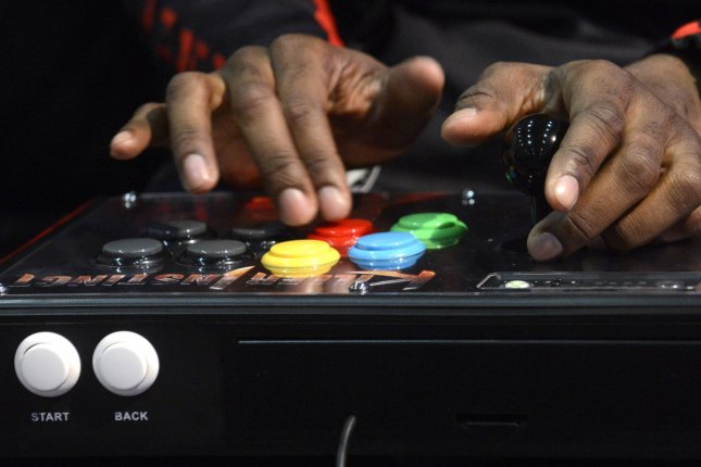 A man plays a game with Mad Catz Arcade Fight Stick. (File/UPI/Phil McCarten)