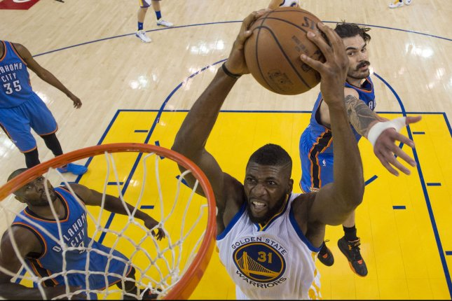 on sale 5ad74 61c70 Golden State Warriors center Festus Ezeli (31) dunks the basketball past  Oklahoma City Thunder center Steven Adams (12) during the first half in  game two of ...