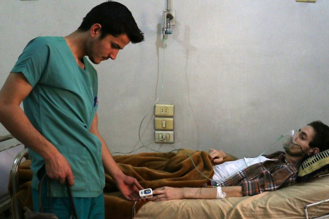 Syrian forces bombed six hospitals in and around Aleppo in the past week, making it the worst week for attacks on medical facilities since the Syrian civil war began, an aid group said. Pictured, a Syrian medic helps a wounded man in the hospital after Russian airstrikes hit the Aleppo province of Syria in May. File Photo by Ameer Alhalbi/UPI
