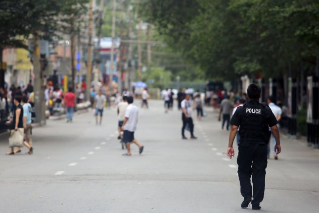 Han Chinese police patrol the streets during Ramadan in what many consider the Muslim capital of China, Urumqi, in the predominantly Muslim and restive Xinjiang Province. File Photo by Stephen Shaver/UPI