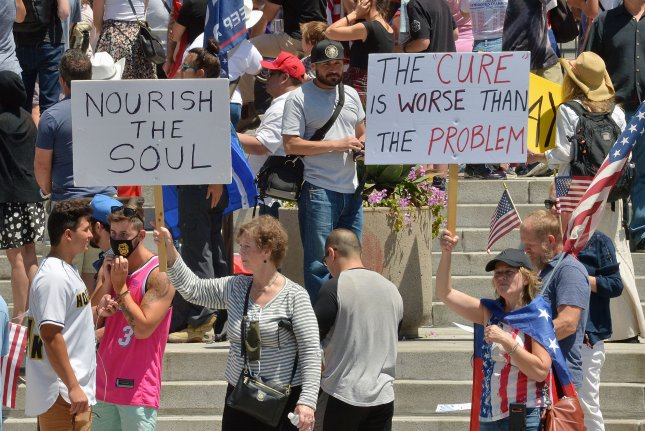 Hundreds of President Trump supporters hold a Freedom Rally calling to open California on the steps of City Hall in Los Angeles on Sunday, May 24, 2020. Officials have said the lockdowns are needed to reduce the spread of the coronavirus. Photo by Jim Ruymen/UPI