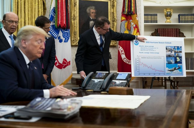 President Donald Trump listens on Thursday as he receives a briefing on the 2020 Atlantic hurricane season, in the Oval Office of the White House. Photo by Doug Mills/UPI/Pool
