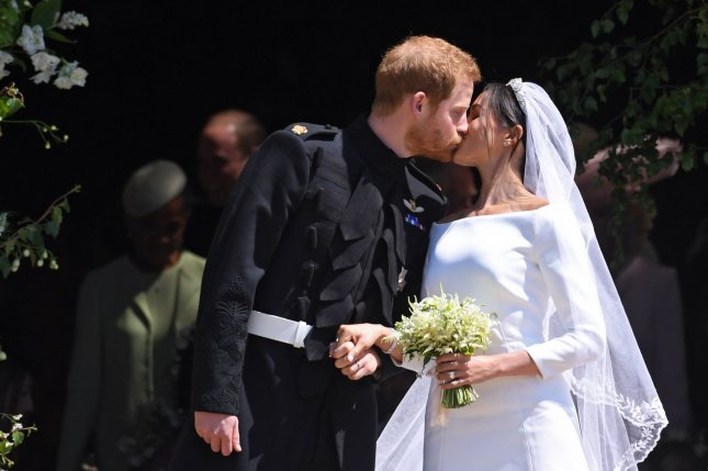 Britain's Prince Harry and Meghan, duchess of Sussex, kiss after they are married at St. George's Chapel in Windsor Castle in Windsor, Britain, on May 19, 2018. File Photo by Neil Hall/UPI/Pool