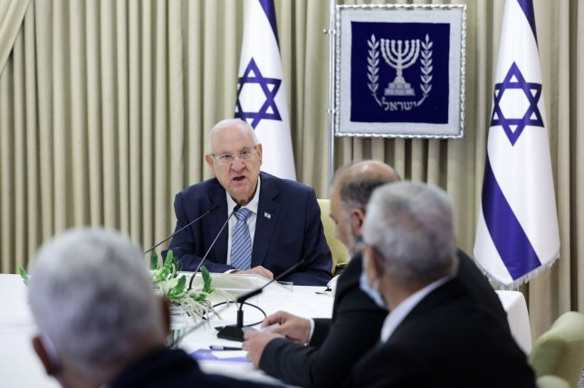 Israeli President Reuven Rivlin speaks Monday with political leaders during discussions about assigning the mandate to form a new coalition government, at the president's residence in Jerusalem, Israel. Photo by Amir Cohen/UPI/Pool