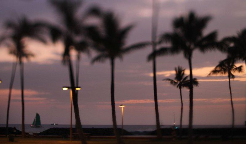 A lone sailboat sails offshore Magic Island next to Ala Moana Beach Park fronting the orange glow during sunset in Honolulu, Hawaii on January 4, 2012. UPI/Cory Lum