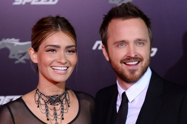 Cast member Aaron Paul and director Lauren Parsekian attend the premiere of the motion picture crime thriller Need for Speed at TCL Chinese Theatre in the Hollywood section of Los Angeles on March 6, 2014. Storyline: Fresh from prison, a street racer who was framed by a wealthy business associate joins a cross country race with revenge in mind. His ex-partner, learning of the plan, places a massive bounty on his head as the race begins. UPI/Jim Ruymen