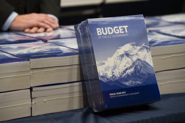 Copies of President Barack Obama's fiscal 2017 budget proposal are displayed for members to pick up, in the Senate Budget Committee room at the Capitol on Tuesday. Photo by Molly Riley/UPI