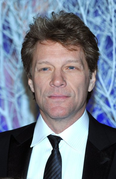 Jon Bon Jovi attends the Centrepoint Winter Whites Gala at Kensington Palace in London on November 26, 2013. The singer surprised a longtime fan, Carol Cesario, over the weekend by inviting her family to his Soul Kitchen, then showing up to dine with her. Cesario has stage 4 lung cancer. UPI/Paul Treadway