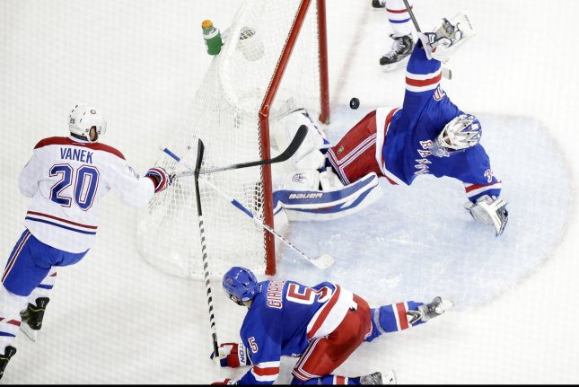New York Rangers Dan Girardi watches Henrik Lundqvist make a save from the stick of Montreal Canadiens Thomas Vanek in the second period in game 6 of the NHL Eastern Conference finals in the 2014 Stanley Cup Playoffs at Madison Square Garden in New York City on May 29, 2014. UPI/John Angelillo