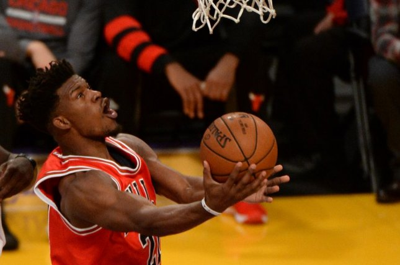 Chicago Bulls forward Jimmy Butler (21) drives through the lane for the easy layup. File photo by Jon SooHoo/UPI