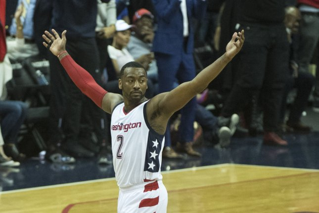 Washington Wizards guard John Wall (2) celebrates after teammate Bradley Beal made a basket in the fourth quarter of game 2 of the Eastern Conference Quarterfinals at the Verizon Center in Washington, D.C. on April 19, 2017. Photo by Kevin Dietsch/UPI