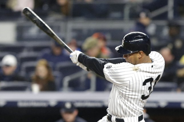 New York Yankees' Aaron Hicks hits the ball. Hicks tied his career high with six RBIs. File photo by John Angelillo/UPI