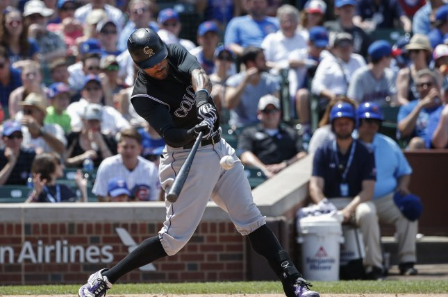 Colorado Rockies' Ian Desmond hits the ball. File photo by Kamil Krzaczynski/UPI