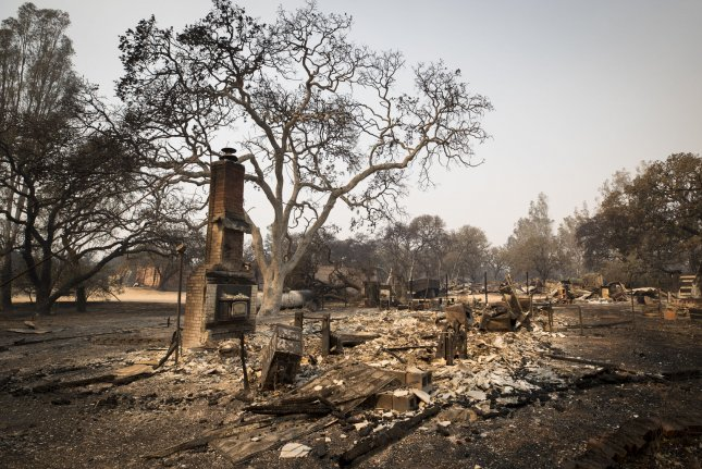 The remains of a home that was devastated by wildfire in Glen Ellen, Calif., on Thursday. Photo by Fred Greaves/UPI