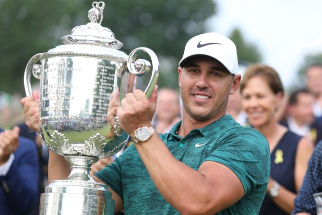 Brooks Koepka hoists the Wannamaker Trophy after winning the 100th PGA Championship at Bellerive Country Club in Town and Country, Mo. on Sunday. Photo by Bill Greenblatt/UPI