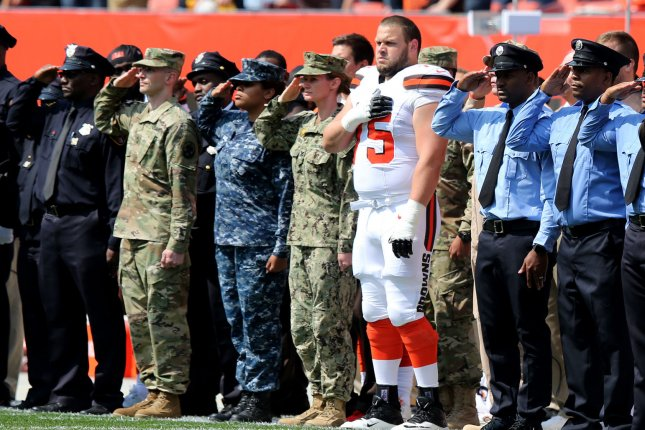 Cleveland Browns offensive lineman Joel Bitonio (C) stands for the national anthem alongside first responders prior to their game against the Pittsburgh Steelers on September 10, 2017 at First Energy Stadium in Cleveland. Photo by Aaron Josefczyk/UPI