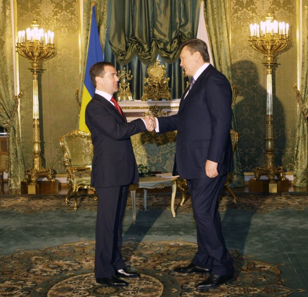 Russian President Dmitry Medvedev (L) shakes hands with newly elected Ukrainian President Viktor Yanukovich before their meeting in the Kremlin in Moscow on March 5, 2010. UPI/Alex Natin.