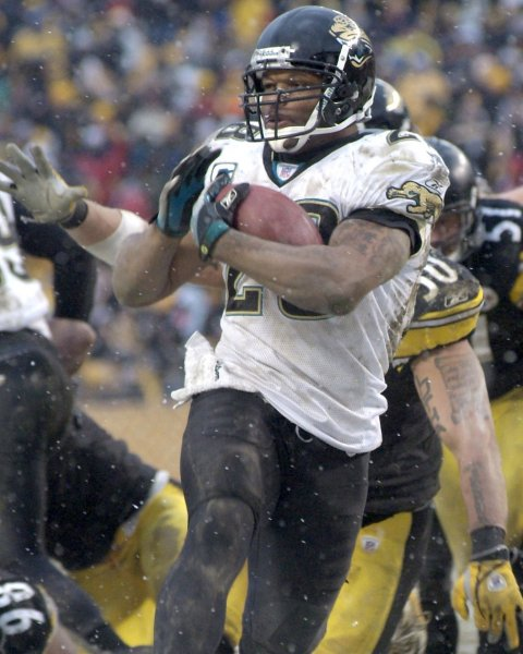 Jacksonville Jaguars Fred Taylor runs 12 yards for the winning touchdown pass the out stretched arms of Pittsburgh Steelers Larry Foote in the fourth quarter of the Jaguars 29 - 22 win at Heinz Field in Pittsburgh on December 16, 2007. (UPI Photo/Archie Carpenter)