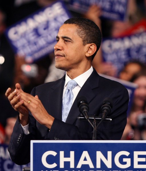 Barack Obama claps his hands during an election night rally at Nashua South High School in Nashua, New Hampshire on January 8, 2008. Obama loses the New Hampshire Primary to Hillary Clinton. (UPI Photo/John Angelillo)