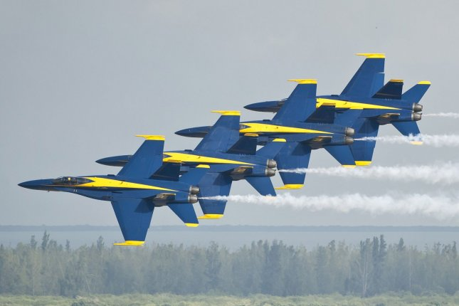 The U.S. Navy Blue Angels aerial demonstration squadron, seen here performing at an air show in Florida, was temporarily grounded Friday, a day after a crash in Tennessee killed a young pilot. Officials said the team had been practicing for an air show this weekend when the crash occurred. File Photo by Joe Marino-Bill Cantrell/UPI