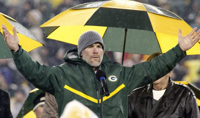 Former Green Bay Packer quarterback Brett Favre reacts to the crowd as his number is retired during a ceremony on Nov. 26, 2015, at Lambeau Field. Photo by Frank Polich/UPI