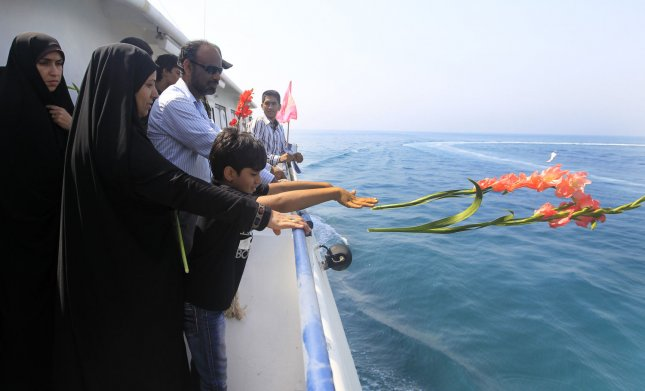 Relatives of victims of an Iranian airliner that was shot down by a U.S. warship participate in a ceremony commemorating the dead in the Persian Gulf off the coast of Iran on July 2, 2012. On July 3, 1988, an Iranian Air Airbus A300 was shot down as it passed over the Persian Gulf, all 290 passengers were killed. File Photo by Maryam Rahmanian/UPI