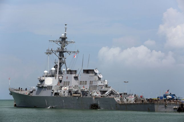 The USS John S. McCain is moored at Changi Naval Base, in Singapore on Monday following a collision with the merchant vessel Alnic MC east of the Straits of Malacca. The U.S. Navy named nine missing sailors Thursday. Photo by Grady T. Fontana/U.S. Navy/UPI