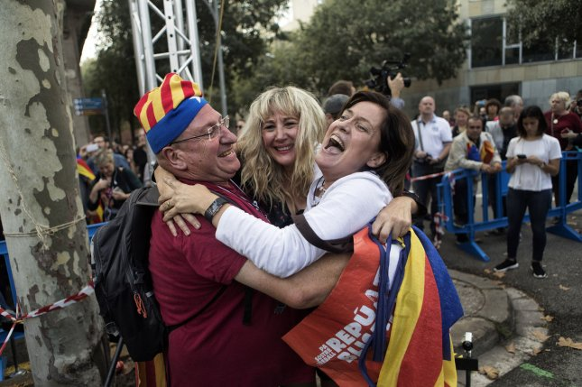 People celebrate the proclamation of a Catalan republic at the Sant Jaume Square in Barcelona, Spain, on Friday. Photo by Xavi Herrero/ UPI