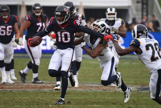 Houston Texans receiver DeAndre Hopkins (10) eludes the tackle of Los Angeles Rams cornerback Trumaine Johnson (22) on November 12, 2017 at the LA Coliseum in Los Angeles, California. File photo by Jon SooHoo/UPI