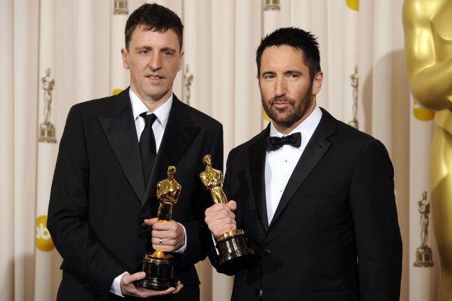 Oscar-winning composers and Nine Inch Nails rockers Trent Reznor (R) and Atticus Ross are creating new music for the HBO series Watchmen. File Photo by Phil McCarten/UPI