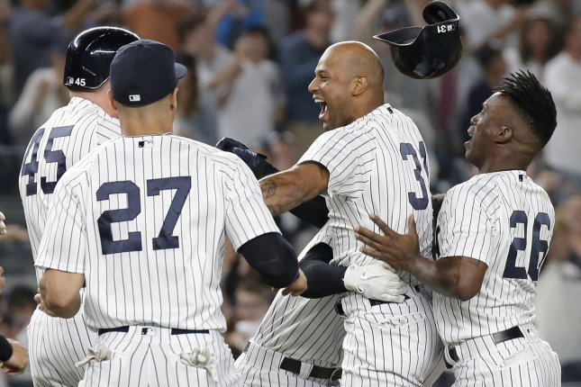 New York Yankees star Aaron Hicks celebrates with teammates after hitting a walk off game winning RBI double in the 11th inning against the Baltimore Orioles on September 22 at Yankee Stadium in New York City. Photo by John Angelillo/UPI