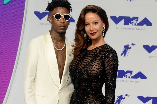 (L-R) 21 Savage and Amber Rose arrive for the 34th annual MTV Video Music Awards in Inglewood on August 27, 2017. 21 Savage's I Am > I Was is No. 1 on the U.S. album chart. File Photo by Jim Ruymen/UPI