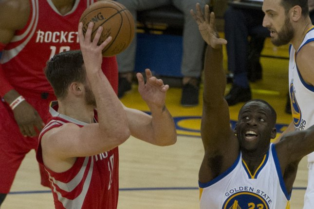 Former Houston Rockets forward Donatas Motiejunas (L) has inked a deal with the San Antonio Spurs to add size and depth for the upcoming NBA postseason. File Photo by Terry Schmitt/UPI