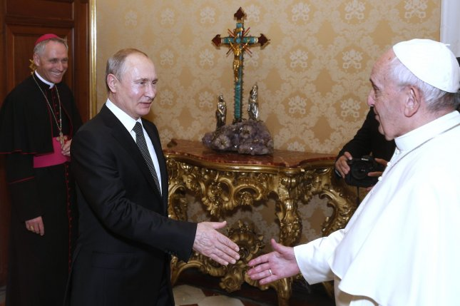 Pope Francis receives Russian President Vladimir Putin during a private audience at the Vatican, on Thursday. Photo by Haring/Spaziani/pool/UPI
