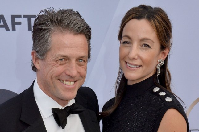 Hugh Grant (L), pictured with Anna Elisabet Eberstein, will tell the story behind his success in the BBC Two special Hugh Grant: A Life on Screen. File Photo by Jim Ruymen/UPI.