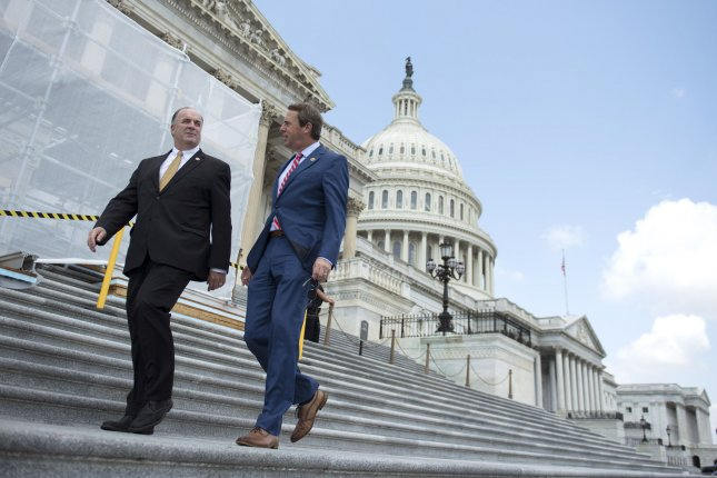 Rep. Mark Walker, R-N.C., (R) walks with Rep. Dan Kildee, D-Mich., outside the U.S. Capitol. Walker said he might run for a Senate seat in 2022. File Photo by Kevin Dietsch/UPI